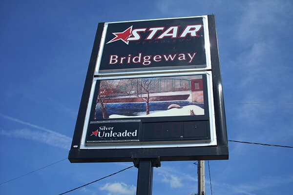 Convenience Stores Star Bridgeway Pole Sign